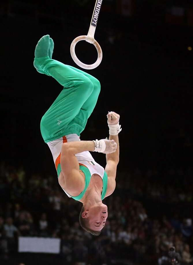 Ireland's Christopher O'Connor dismounts from the rings during a qualification session at the Artistic Gymnastics World Championships in Antwerp, Belgium on Monday, Sept. 30, 2013. The event will take place from Monday, Sept. 30 until Sunday, Oct. 6. Photo: Virginia Mayo, Associated Press