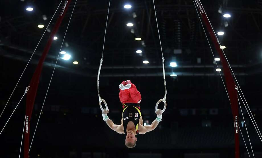 Germany's Fabien Hambuechen performs on the rings during a qualification session at the Artistic Gymnastics World Championships in Antwerp, Belgium on Monday, Sept. 30, 2013. The event will take place from Monday, Sept. 30 until Sunday, Oct. 6. Photo: Virginia Mayo, Associated Press