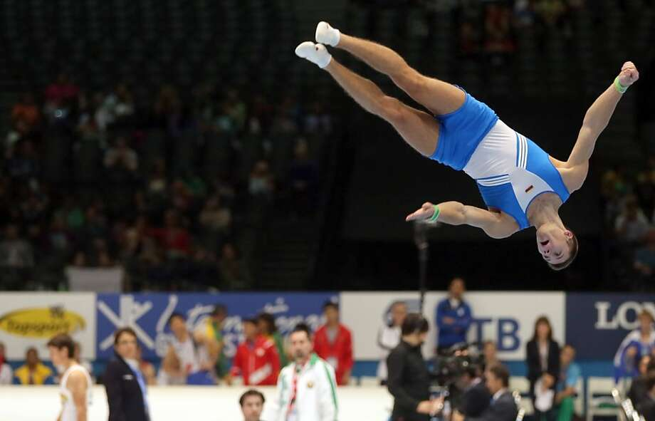 Lithuania's Vladislav Esaulov performs during the floor exercise qualification session at the Artistic Gymnastics World Championships in Antwerp, Belgium on Monday, Sept. 30, 2013. The event will take place from Monday, Sept. 30 until Sunday, Oct. 6. Photo: Virginia Mayo, Associated Press