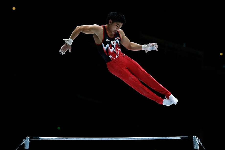 Koji Yamamuro of Japan competes in the High Bar Qualification on  Day One of the Artistic Gymnastics World Championships Belgium 2013 held at the Antwerp Sports Palace on September 30, 2013 in Antwerpen, Belgium. Photo: Dean Mouhtaropoulos, Getty Images