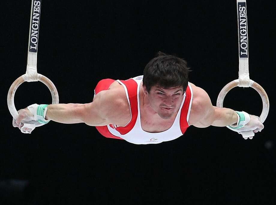 Gymnast Kevin Lytwyn from Canada performs on the rings,  during the qualification round at the artistic gymnastics World Championships in Antwerp, Belgium, Monday, Sept. 30, 2013. The event takes place from Sept. 30, until Sunday, Oct. 6. Photo: Yves Logghe, Associated Press