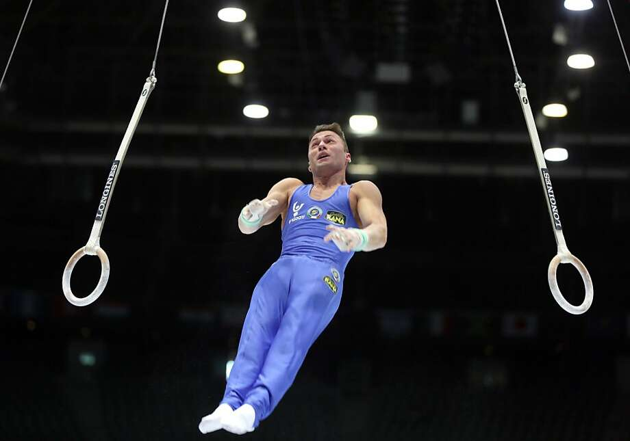 Italy's Marco Lodadio dismounts from the rings during a qualification session at the Artistic Gymnastics World Championships in Antwerp, Belgium on Monday, Sept. 30, 2013. The event will take place from Monday, Sept. 30 until Sunday, Oct. 6. Photo: Virginia Mayo, Associated Press