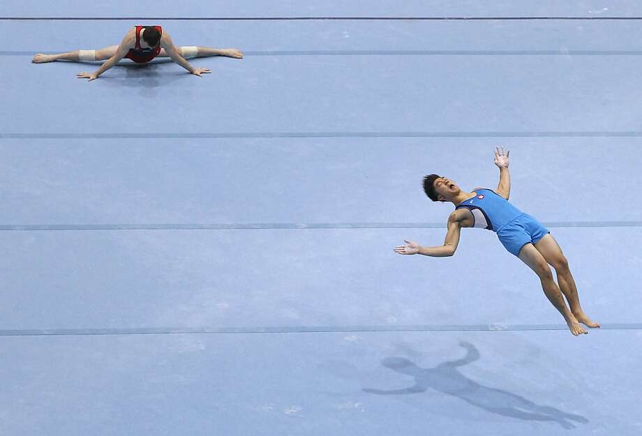 Gymnasts train for the floor exercise, prior to the qualification round at the artistic gymnastics World Championships in Antwerp, Belgium, Monday, Sept. 30, 2013. The event takes place from Sept. 30, until Sunday, Oct. 6. Photo: Yves Logghe, Associated Press