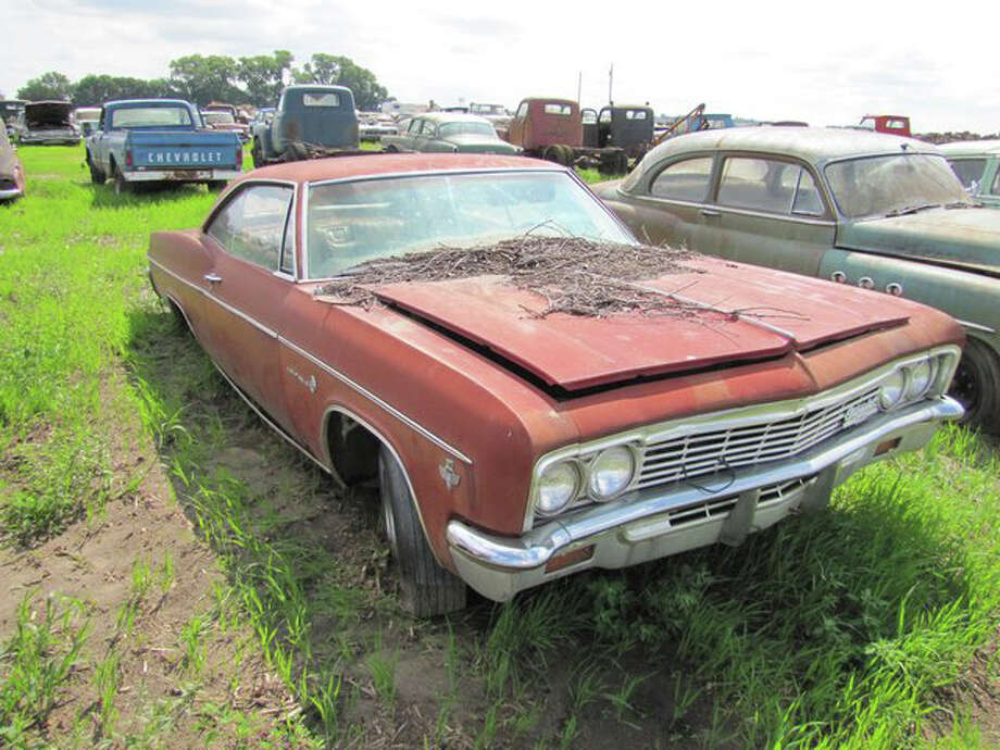1966 Chevrolet Impala 2 door hardtop (6,549 miles) -> sold for $15,500