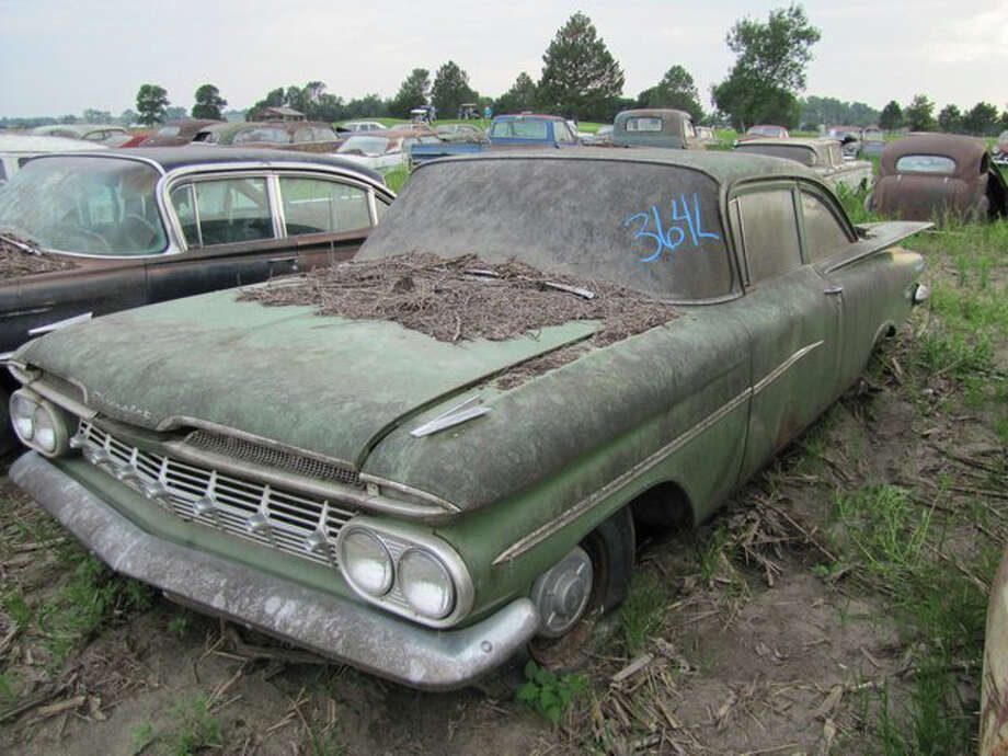1959 Chevrolet Biscayne 2 door sedan (25,112 miles) -> sold for $12,500