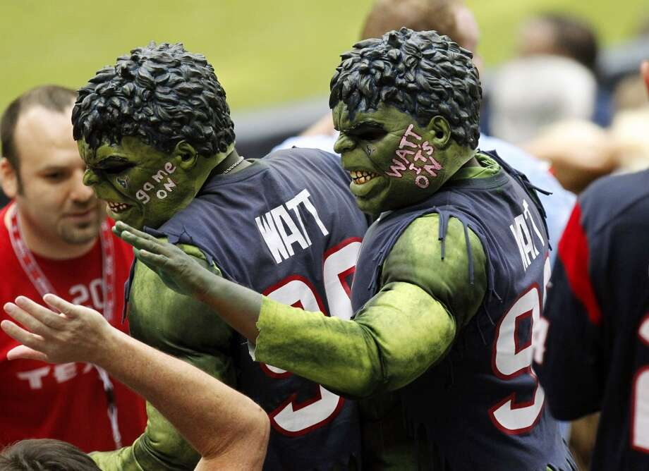 Texans fans dressed as the Incredible Hulk greet other fans during the first quarter. Photo: Cody Duty, Houston Chronicle