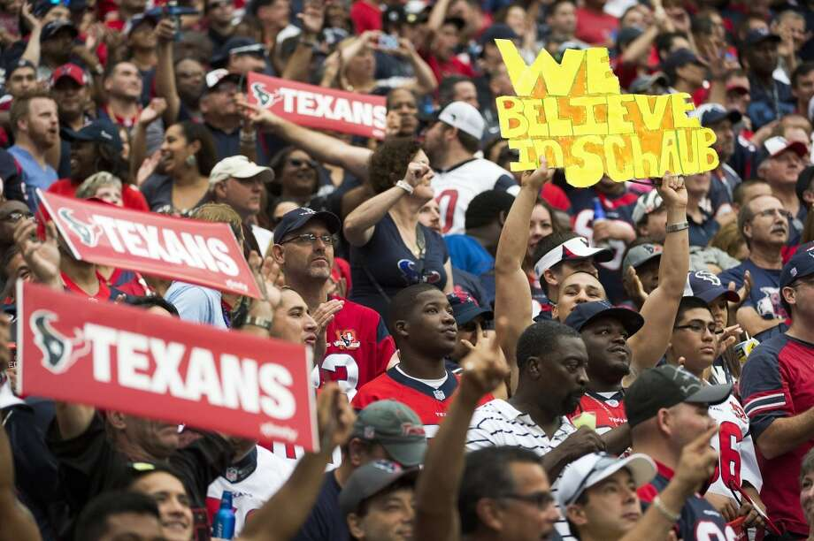 A fan holds up a sign in support of Texans quarterback Matt Schaub during the first half. Photo: Smiley N. Pool, Houston Chronicle