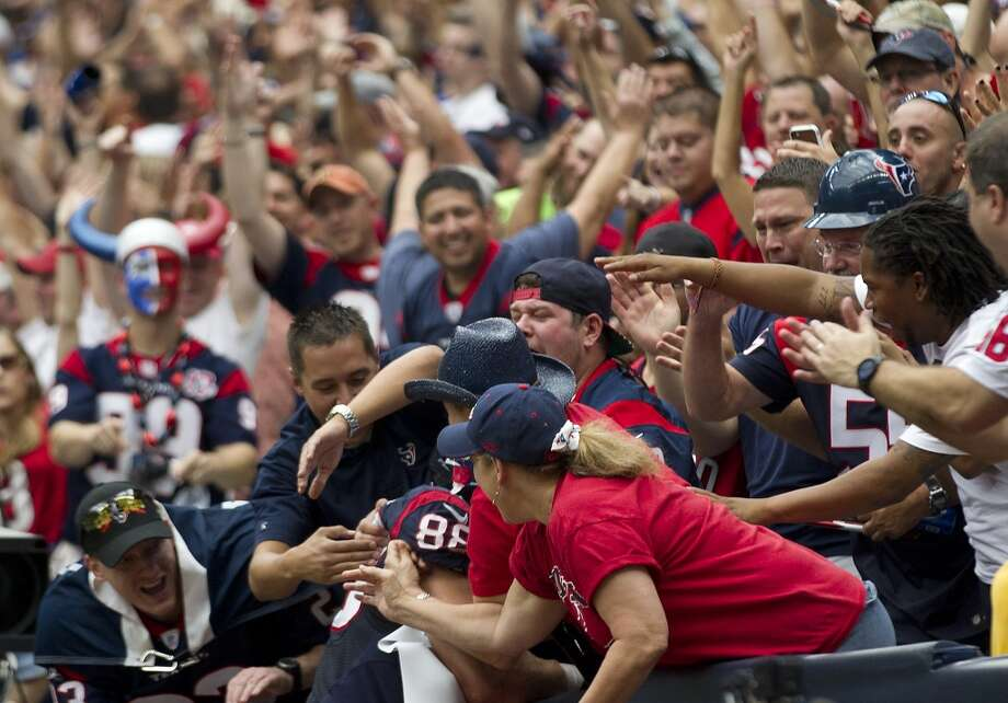 Texans fans greet tight end Garrett Graham after he scored a touchdown during the second quarter. Photo: Brett Coomer, Houston Chronicle