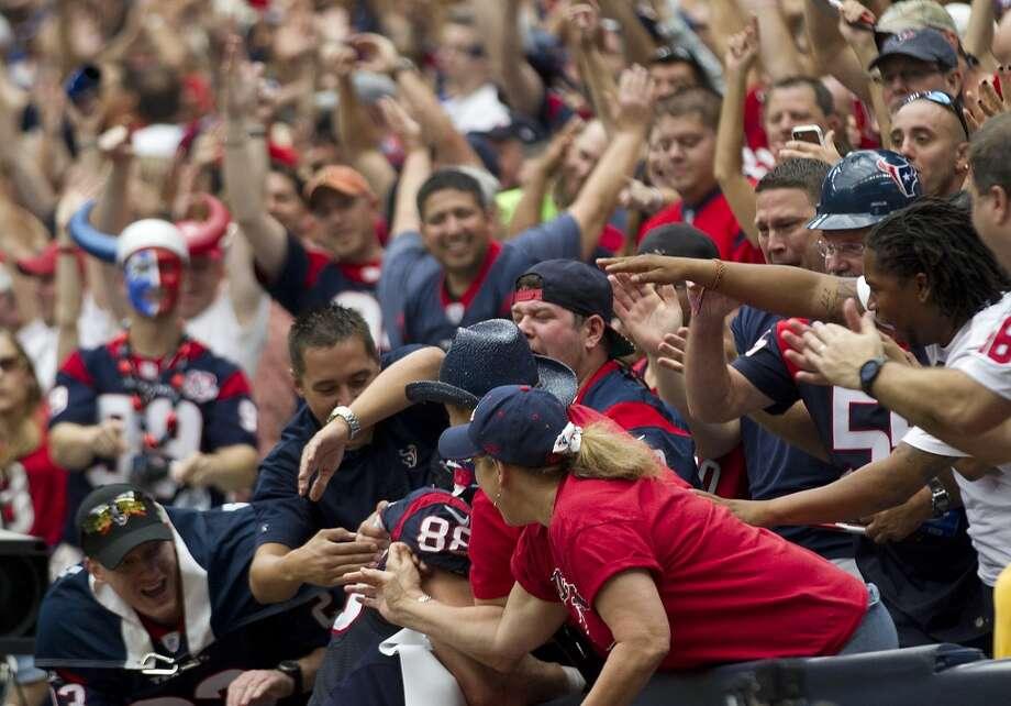 Texans fans greet tight end Garrett Graham after he scored a touchdown during the second quarter. Photo: Brett Coomer, Houston Chronicle