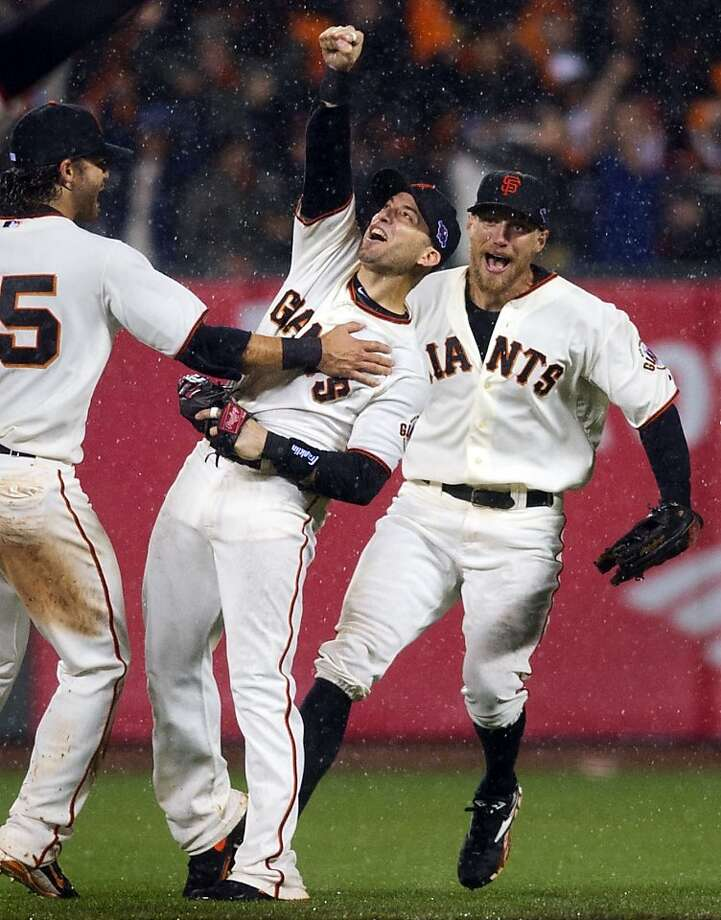 13. Marco Scutaro in the rain — the indelible image from the 2012 San Francisco Giants' NLCS victory over the St. Louis Cardinals. The Giants rallied back from down three games to one, clinching a spot in the World Series with a rainy 9-0 victory at home. Photo: Randy Pench, Associated Press