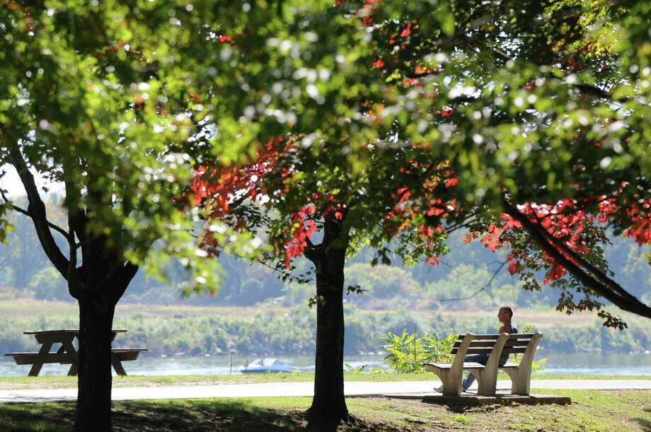 Splashes of fall foliage added to the pleasant surroundings along the Hudson River Sunday afternoon, Sept. 29, 2013, at Jennings Landing in Albany, N.Y. (Will Waldron/Times Union) Photo: WW, Albany Times Union