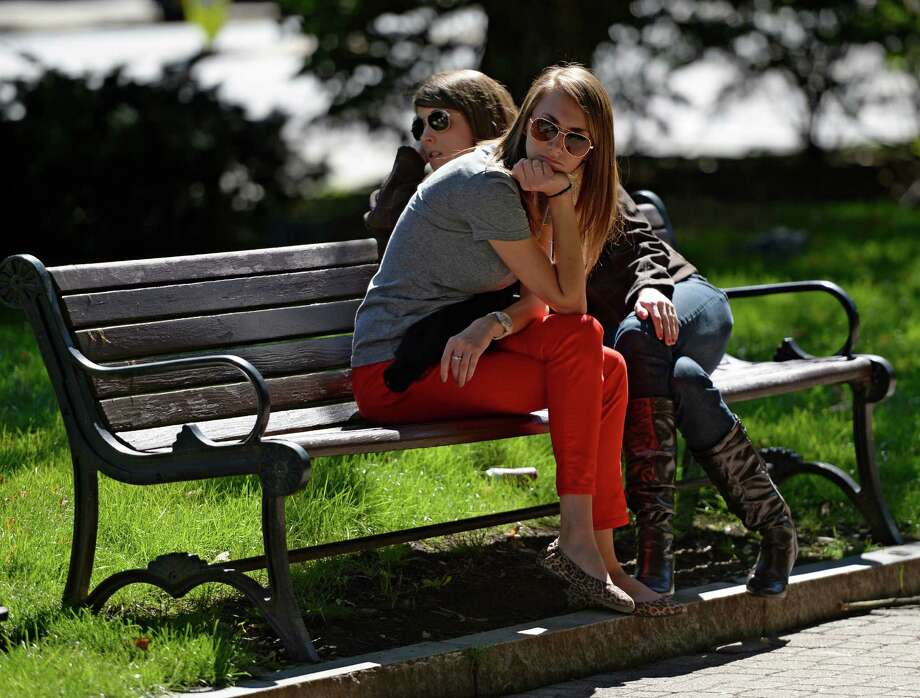 Victoria Polsonilli, 24, of Voorheesville, left, and Amanda Wheeler, 27, of Colonie enjoy a beautiful afternoon Wednesday, Sept. 25, 2013, at Tricentennial Park in Albany, N.Y. (Skip Dickstein / Times Union) Photo: Skip Dickstein, ALBANY TIMES UNION