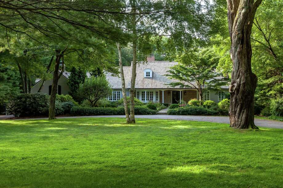 The Cape Cod house at 90 Parade Hill Lane in New Canaan is situated on a cul-de-sac, offering an abundance of privacy. Photo: Contributed