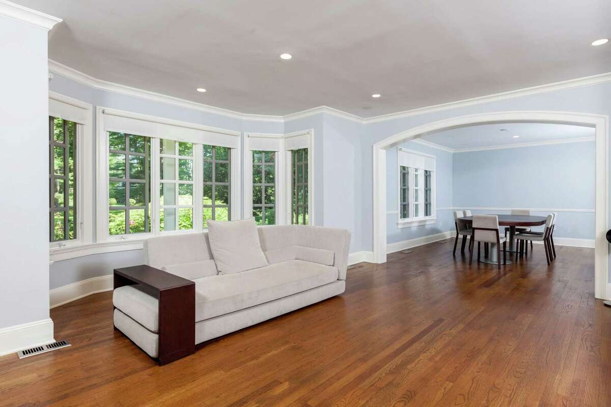 A large archway at 90 Parade Hill Lane in New Canaan divides the living room and dining room spaces.