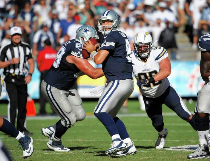 Dallas Cowboys quarterback Tony Romo (9) plays during an NFL football game against the San Diego Cha