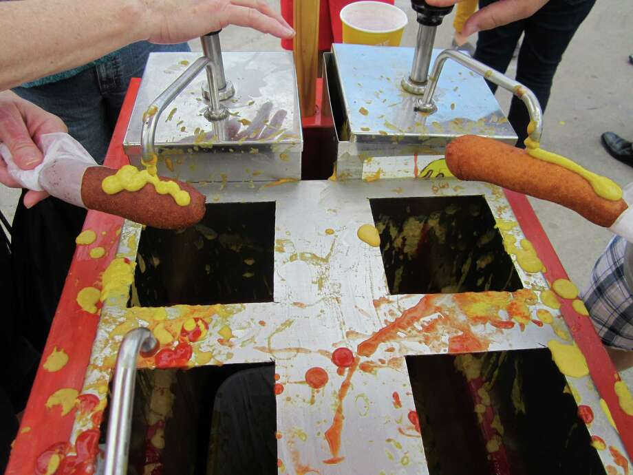 State Fair of Texas attendees seem to prefer mustard over ketchup as their condiment of choice for Fletcher's famous corny dog.