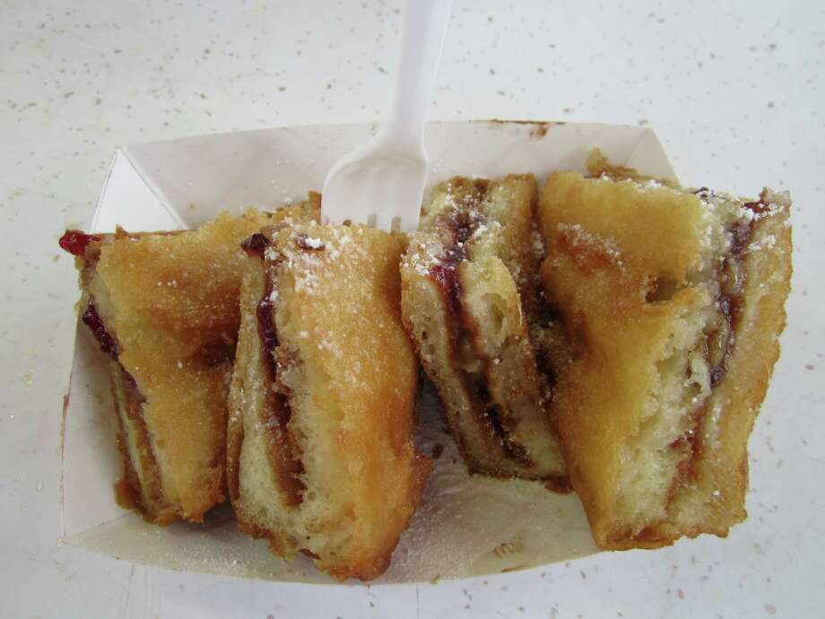 State Fair of Texas attendees formed long lines in front of food vendor Vandalay Ind. to score one of its famous deep fried peanut butter & jelly and banana sandwiches.