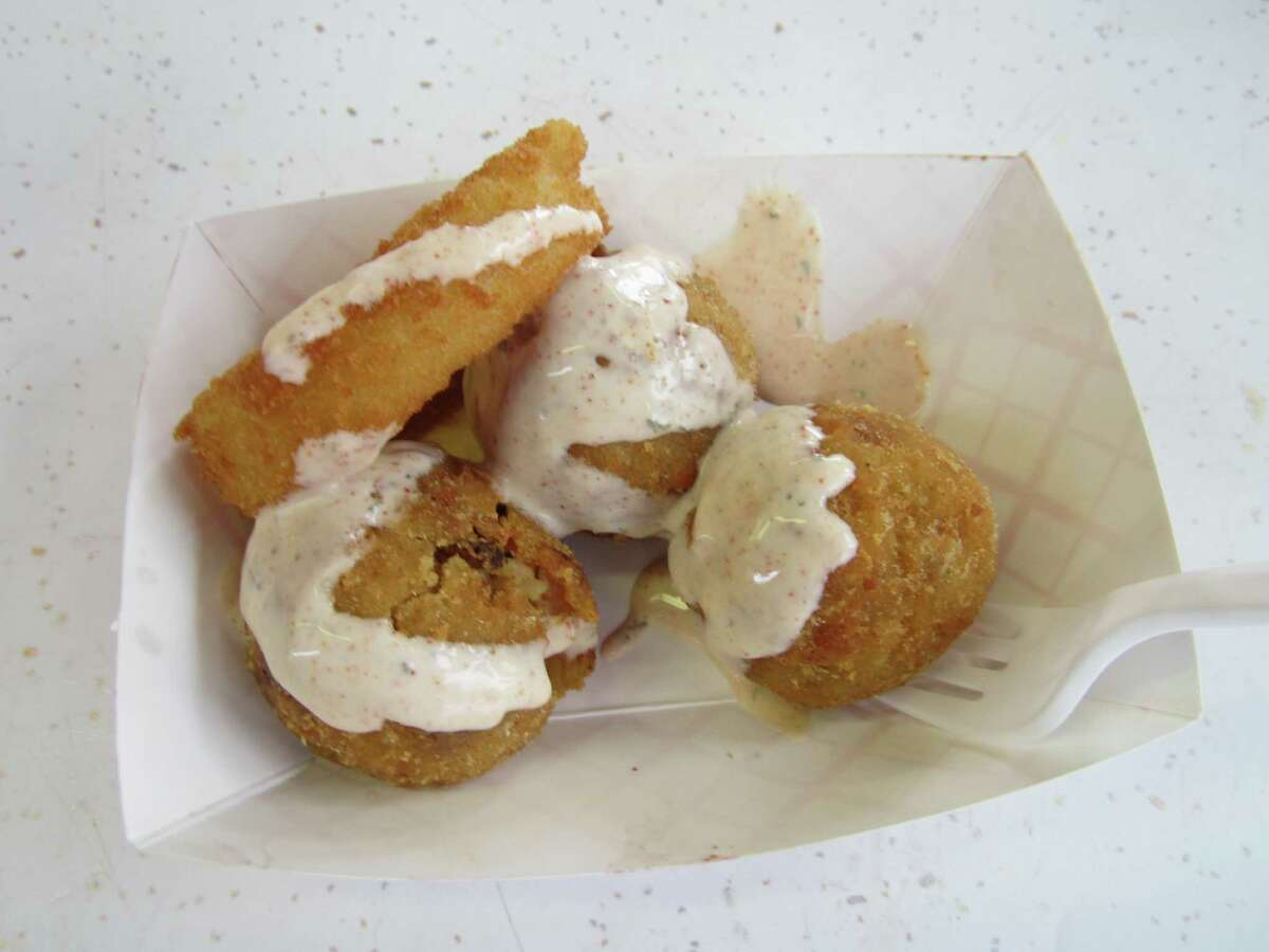 State Fair of Texas attendees formed long lines in front of food vendor Vandalay Ind. to score one of its award-winning deep fried jambalaya balls.
