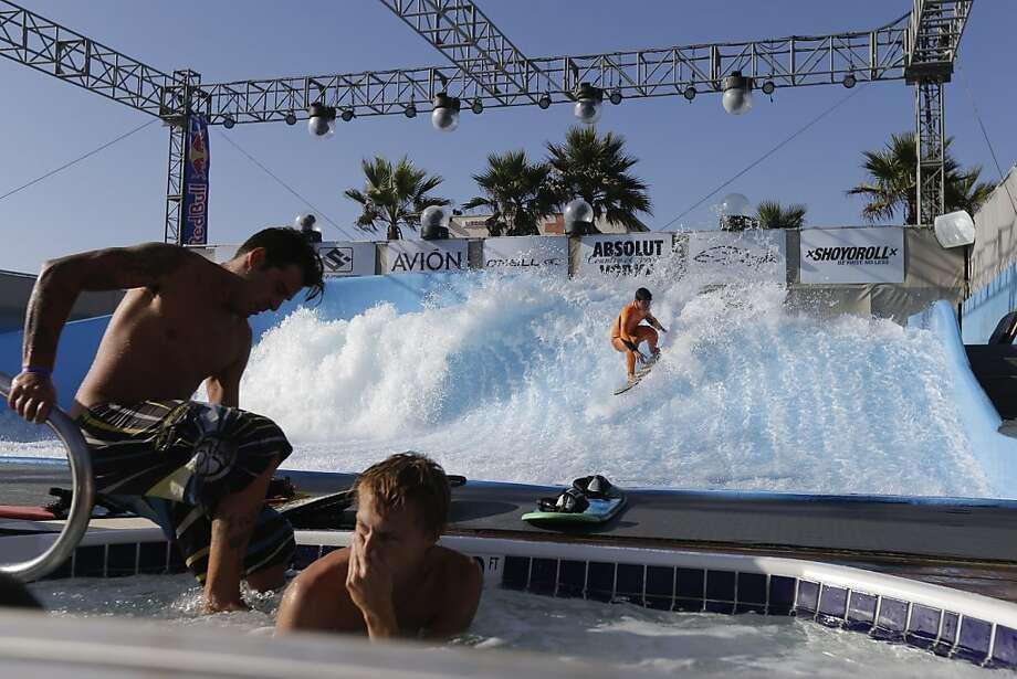 Pro surfer Gabriel Medina of Brazil practices on Wavehouse San Diego's machine-made wave. Photo: Gregory Bull, Associated Press