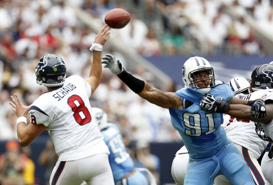 Titans defensive end Derrick Morgan tips a pass by Matt Schaub during the second quarter. Photo: Karen Warren, Houston Chronicle