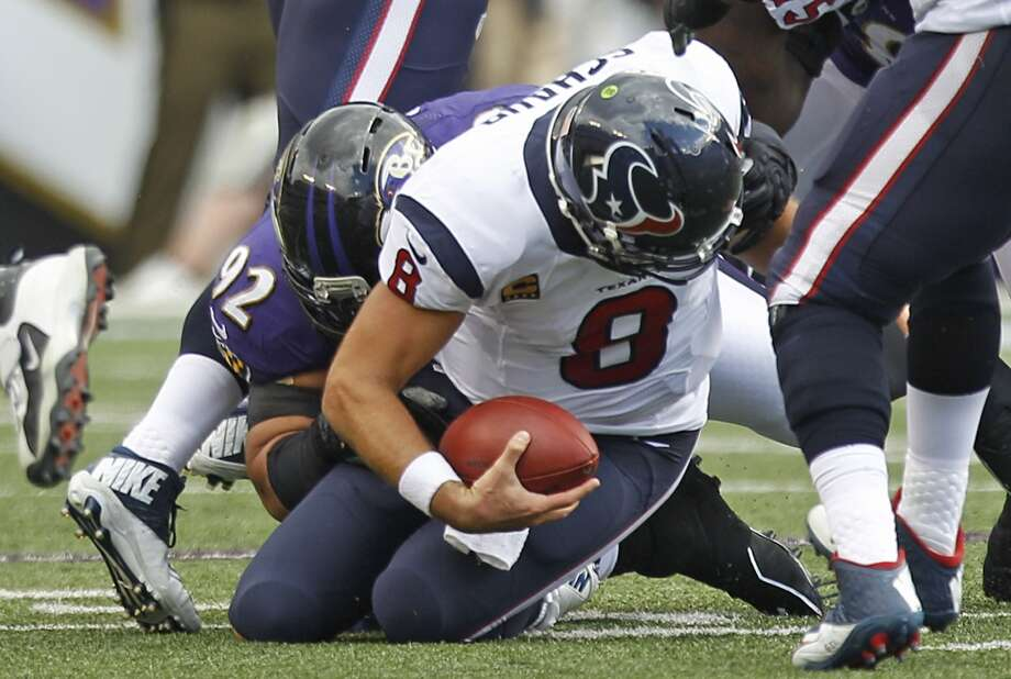Week 3 at Ravens  Matt Schaub is sacked by Baltimore Ravens defensive tackle Haloti Ngata during the second quarter. Photo: Brett Coomer, Houston Chronicle