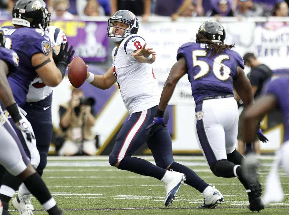 Matt Schaub is chased out of the pocket by Ravens inside linebacker Josh Bynes (56) during the second quarter. Photo: Brett Coomer, Houston Chronicle