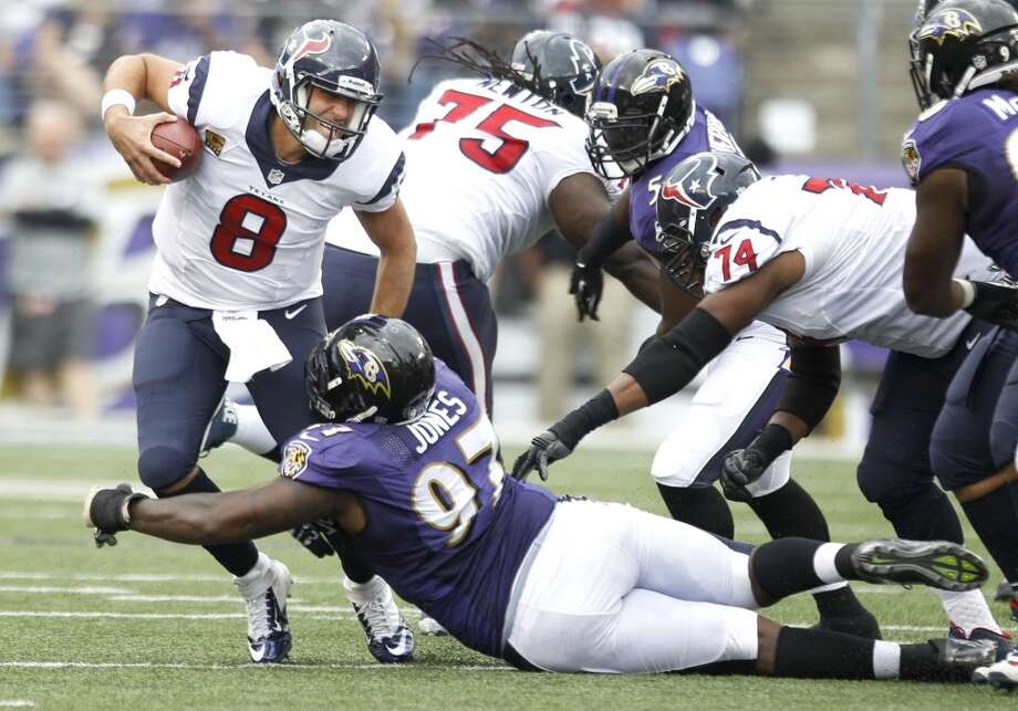 Matt Schaub is sacked by Ravens defensive end Arthur Jones (97) during the fourth quarter. Photo: Brett Coomer, Houston Chronicle