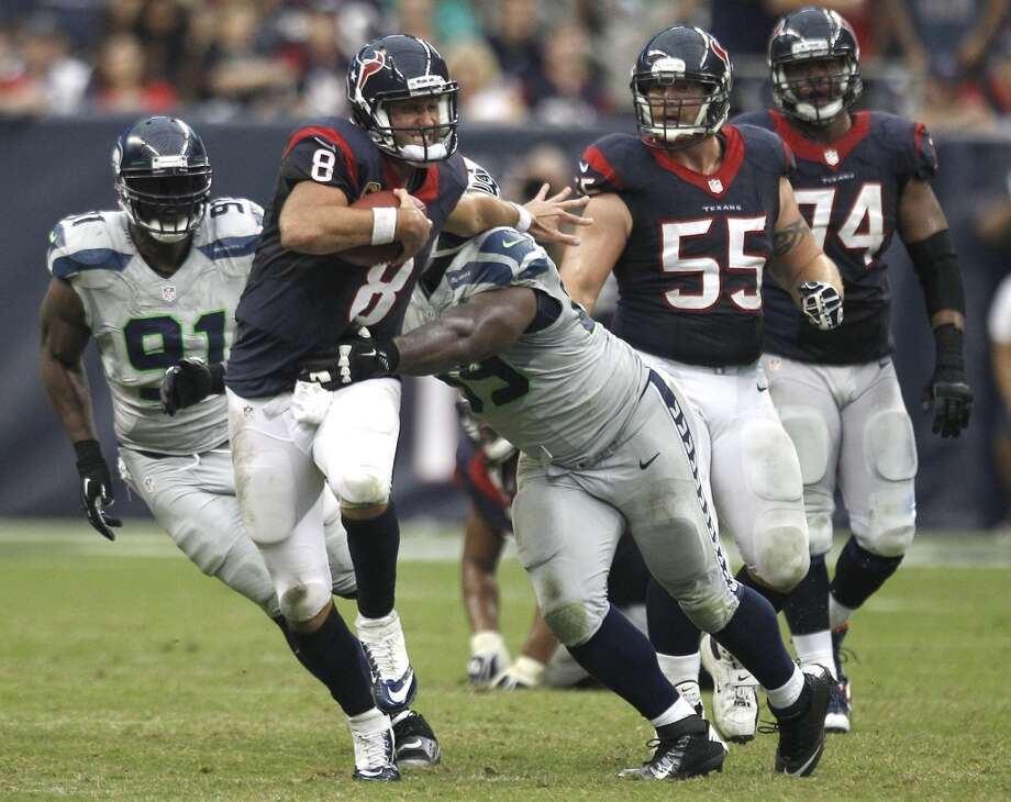 Matt Schaub is tackled by Seahawks defensive tackle Clinton McDonald (69) after Schaub was forced out of the pocket in overtime. Photo: Brett Coomer, Houston Chronicle