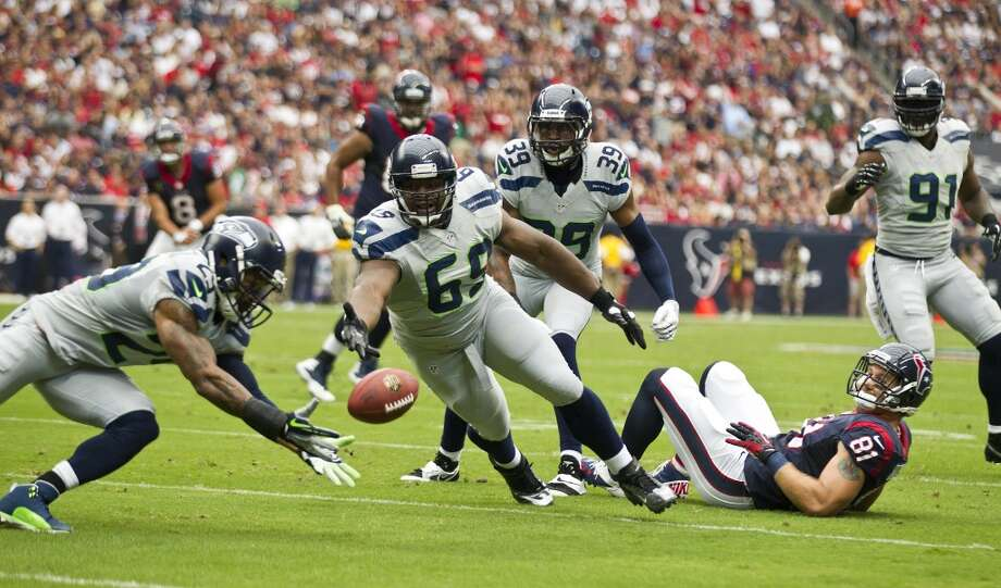 Seahawks free safety Earl Thomas (29) dives to intercept a pass by Matt Schaub during the first quarter. Photo: Brett Coomer, Houston Chronicle