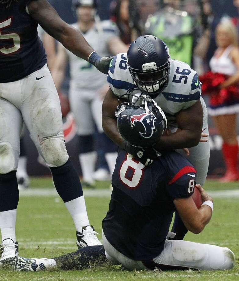 Seahawks defensive end Cliff Avril sacks Matt Schaub during the fourth quarter. Photo: Cody Duty, Houston Chronicle