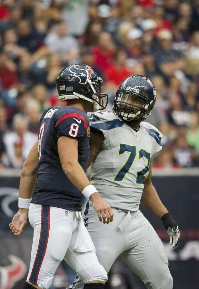 Matt Schaub has words with Seahawks defensive end Michael Bennett during the first half. Photo: Smiley N. Pool, Houston Chronicle