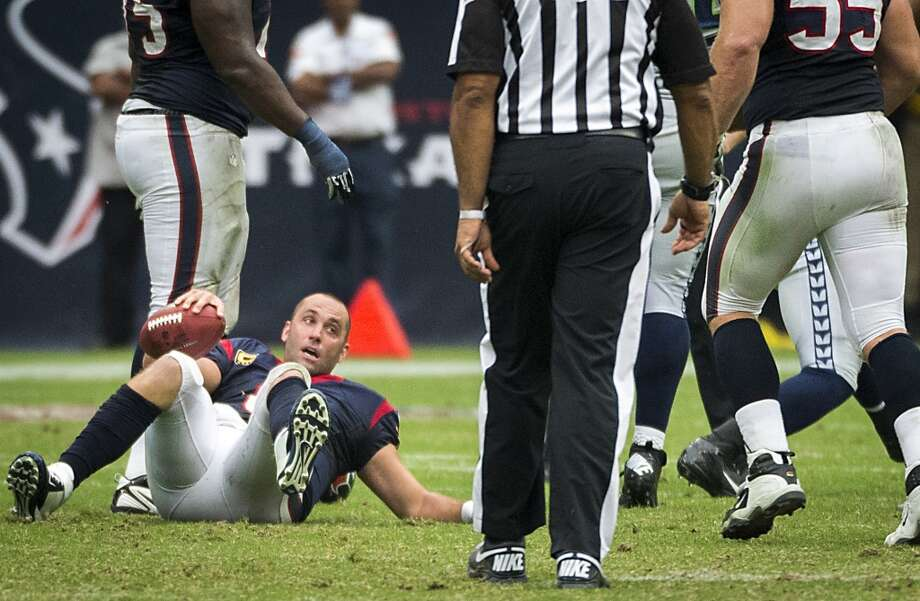 Matt Schaub gets up after being sacked during the second half. Photo: Cody Duty, Houston Chronicle