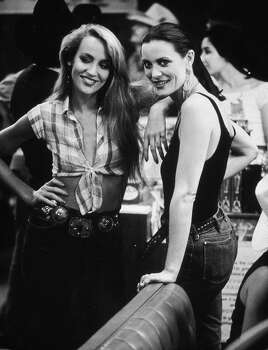 American model and actor Jerry Hall and her sister, Cindy, at a party for director James Bridges's film 'Urban Cowboy' held at Gilley's in Pasadena, Texas. Photo: Getty Images