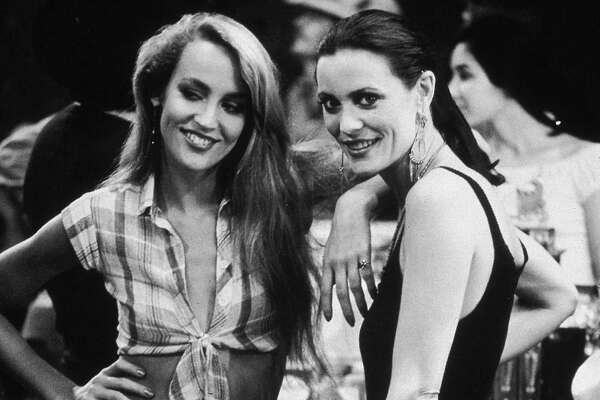 American model and actor Jerry Hall and her sister, Cindy, at a party for director James Bridges's film 'Urban Cowboy' held at Gilley's, Pasadena, Texas.