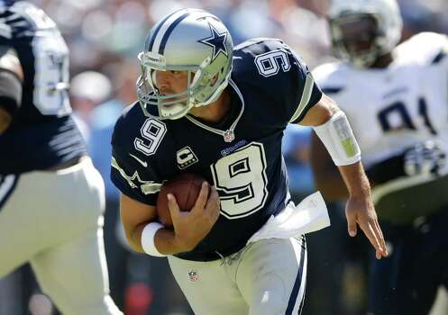 Dallas Cowboys quarterback Tony Romo runs the ball against the San Diego Chargers of an NFL football game Sunday, Sept. 29, 2013, in San Diego. Photo: Gregory Bull