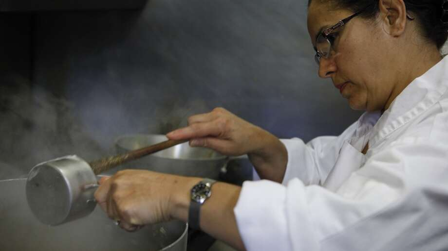Meral Guvenc prepares Icli Kofte. Photo: Russell Yip, The Chronicle