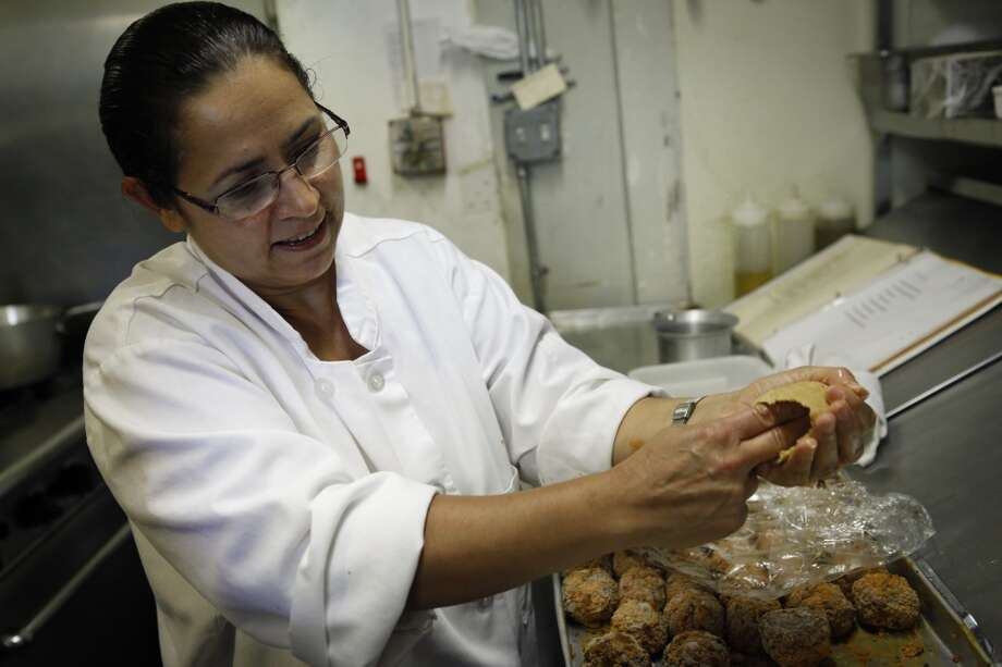 Meral Guvenc demonstrates how to create the bulgar shell. Photo: Russell Yip, The Chronicle