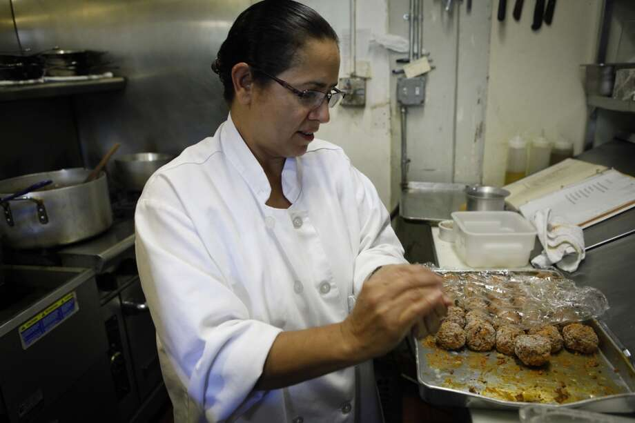 Meral Guvenc prepares Icli Kofte in her family's restaurant, Tuba. Photo: Russell Yip, The Chronicle