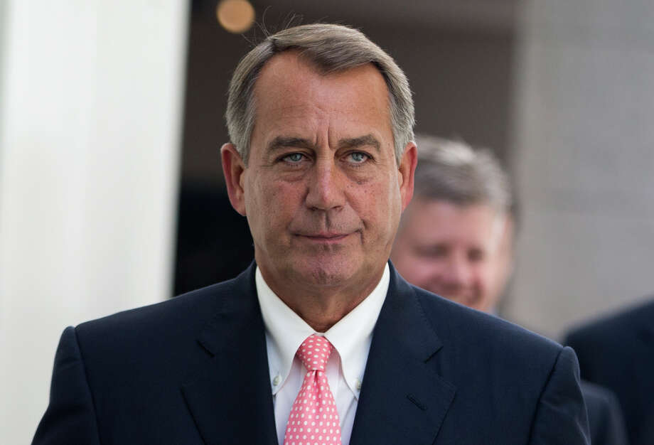 House Speaker John Boehner of Ohio walks to a House Republican Conference meeting to discuss the ongoing budget fight, Monday, Sept. 30, 2013, on Capitol Hill in Washington. Republican unity showed unmistakable signs of fraying Monday as Democrats and the White House vowed to reject tea party-driven demands to delay the nation's health care overhaul as the price for averting a partial government shutdown at midnight. Photo:  Evan Vucci