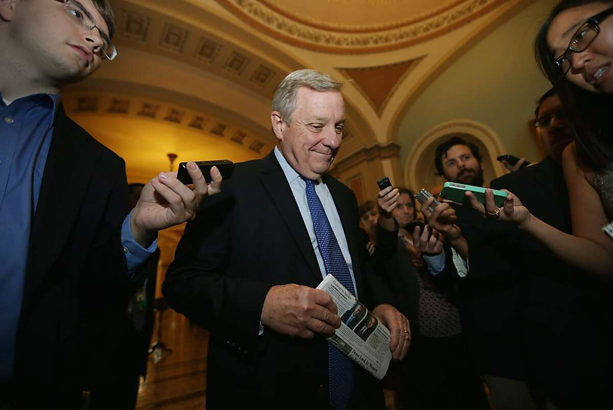 WASHINGTON, DC - SEPTEMBER 30: Senate Majority Whip Richard Durbin (D-IL) talks with reporters before attending a Senate Democratic caucus meeting at the U.S. Capitol September 30, 2013 in Washington, DC. If the House Republicans do not find common ground with President Obama and Senate Democrats on the federal budget then at midnight large sections of the government will close, hundreds of thousands of workers would be furloughed without pay, and millions more would be asked to work for no pay. (Photo by Chip Somodevilla/Getty Images)