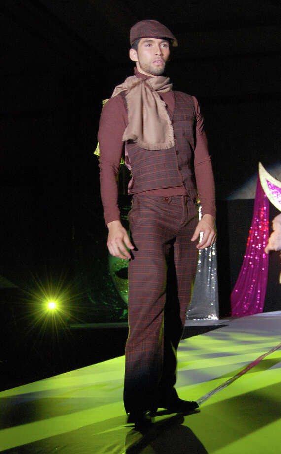 Sami Torrealba, originally from Venezuela, works the runway in the Discover Your Beauty Fashion Show in 2009. Photo: Contributed Photo