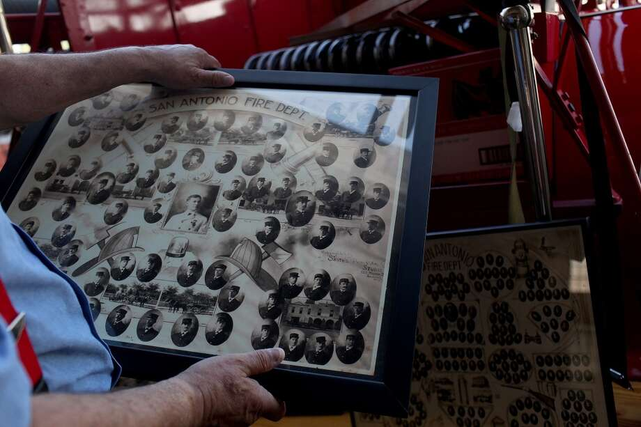 Hector Cardenas, who retired in 2001 after 34 years as a firefighter with the San Antonio Fire Department, packs up historic pictures at the San Antonio Fire Museum. Photo: Lisa Krantz, San Antonio Express-News