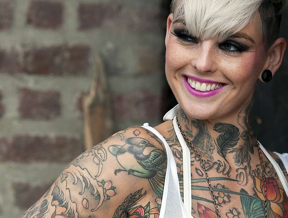 Art collector:A well-inked Briton is happy to show off her illustrations at the London Tattoo Convention. Photo: Will Oliver, AFP/Getty Images