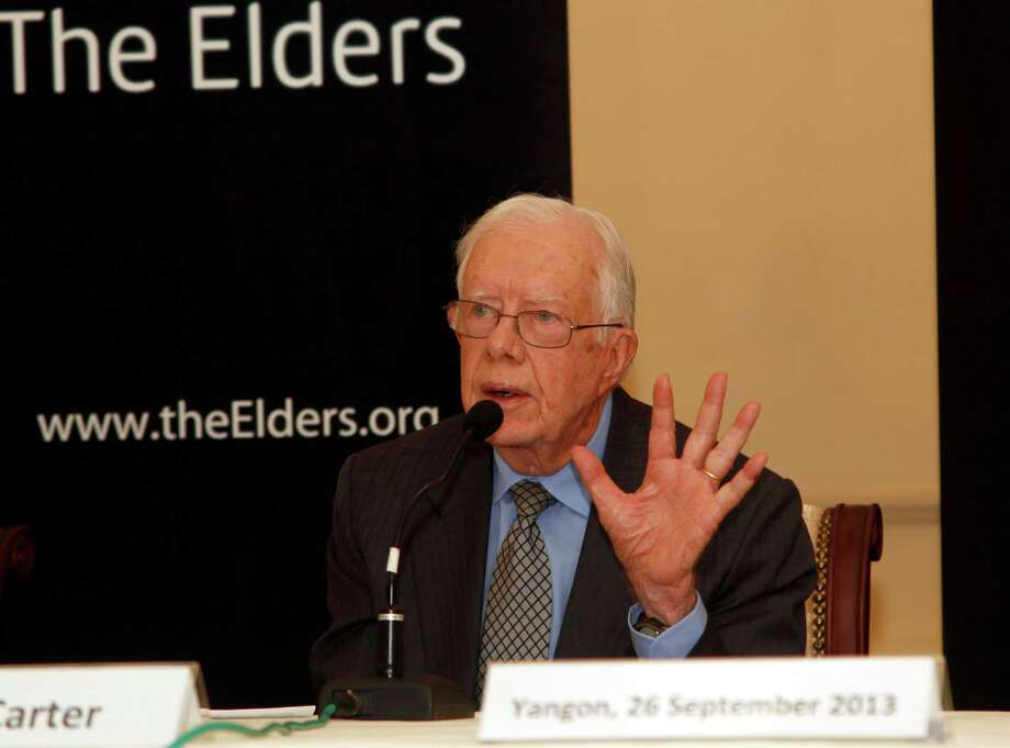 "Jimmy Carter, a former U.S. president, talks to journalists during a press conference at Strand Hotel in Yangon, Myanmar, Thursday, Sept. 26, 2013. Carter and other former world leaders, known as ""The Elders,"" wrapped up a visit to Myanmar with calls to address spiraling Buddhist-led violence against minority Muslims. Myanmar's transition from a half-century of military dictatorship to a budding democracy won widespread praise from Carter and two other visiting ""Elders,"" who pointed to the release of thousands of political prisoners, cease-fire agreements with many of the country's armed ethnic groups and an end to censorship. (AP Photo/Khin Maung Win) ORG XMIT: MYN103 Photo: Khin Maung Win / AP"
