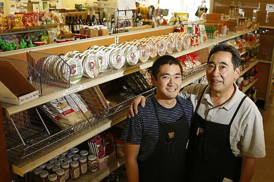 Gene Takahashi (right) is the third-generation owner of San Mateo's Takahashi Market, where his son, Bobby, helps out. The store, founded in 1906, has Hawaiian and Asian food. Photo: Sean Havey, The Chronicle