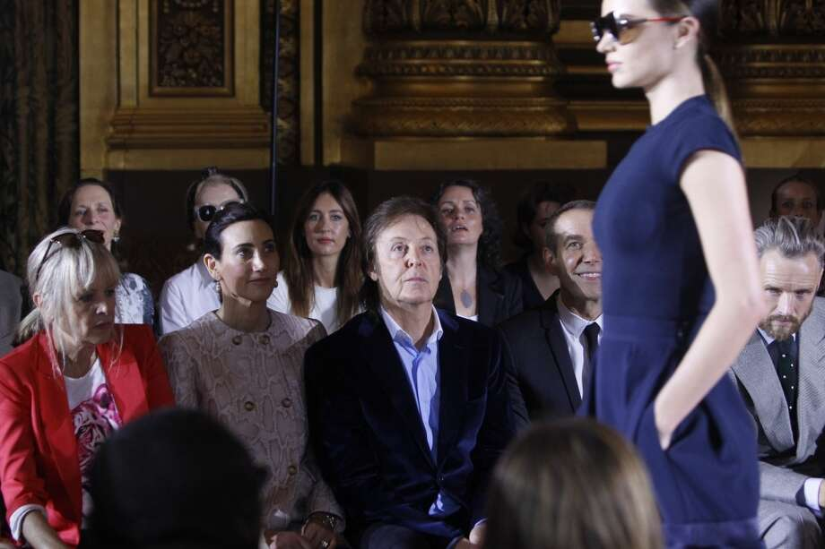 From second left, Nancy Shevell, Sir Paul McCartney and Jeff Koons watch a model during the presentation of Stella McCartney's ready-to-wear Spring/Summer 2014 fashion collection. Photo: Thibault Camus, Associated Press