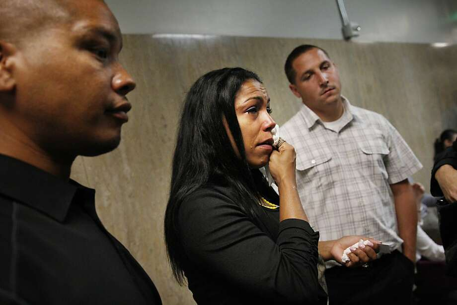 Lakesha James (center), daughter of Jill May, wipes a tear from her face as she answers a reporter's questions while standing with her husband Gary James (left) and brother Ricky James Jr. (right) outside of Department 24 at the Hall of Justice on Monday, September 30, 2013 in San Francisco, Calif. Photo: Lea Suzuki, The Chronicle