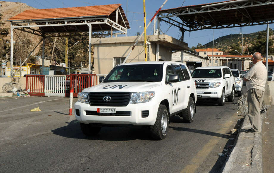 A convoy of United Nations vehicles carrying a team of inspectors charged with overseeing the destruction of Syria's chemical weapons arrives in Beirut Monday. Photo: Getty Images