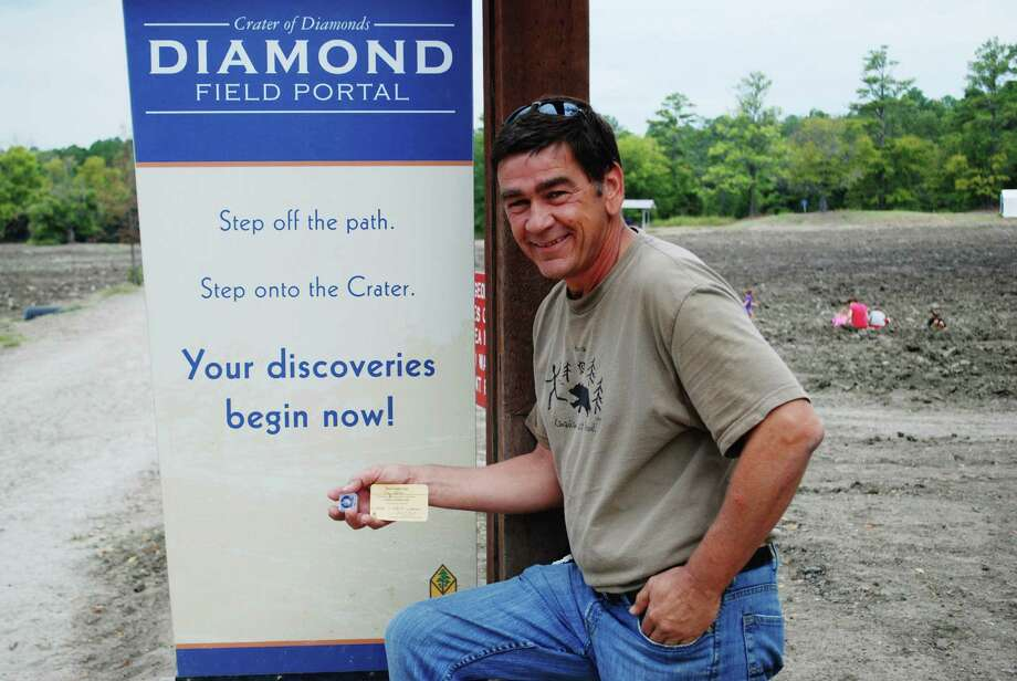 This photo provided by the Crater of Diamonds State Park shows Clay Jarvis holding his 2.13-carat, champagne brown diamond at Arkansas' Crater of Diamonds State Park on Saturday, Sept. 28, 2013. Jarvis of San Antonio was nearby on business when he decided to visit the park, which is the only diamond-producing site open to the public. (AP Photo/Crater of Diamonds State Park) Photo: Associated Press / Crater of Diamonds State Park