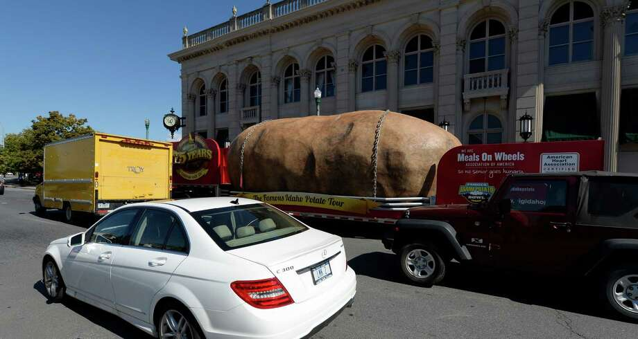 A 12,000-pound replica of a potato arrived Monday morning, Sept. 30, 2013, in Troy, N.Y. The Famous Idaho Potato Tour travels the country to raise funds and awareness for Meals On Wheels, a non-profit organization that delivers more than 1 million meals each day to homebound seniors. (Skip Dickstein / Times Union) Photo: Skip Dickstein / 00024054A